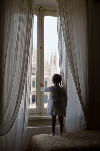 Adorable little girl on rooftop of Duomo, Milan, Italy