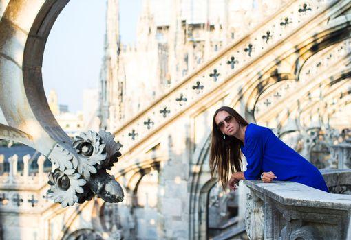 Beautiful woman on on rooftop of Duomo, Milan, Italy