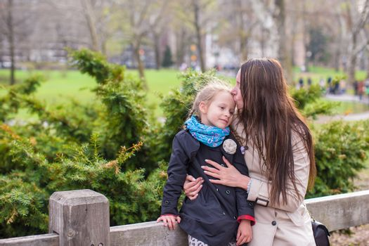 Young mother and her daughter for a walk in Central Park