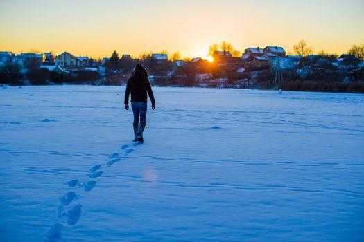 Man walking on deep snowy field