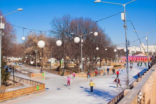 General view of people skating on ice rink