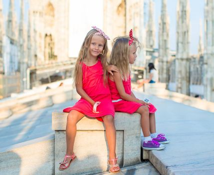 Adorable little girls on rooftop of Duomo, Milan, Italy