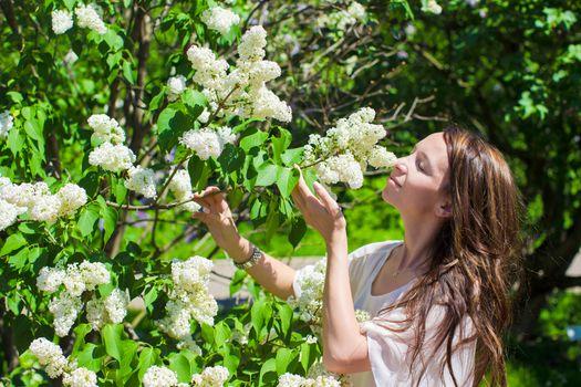 Young beautiful woman in the lush garden