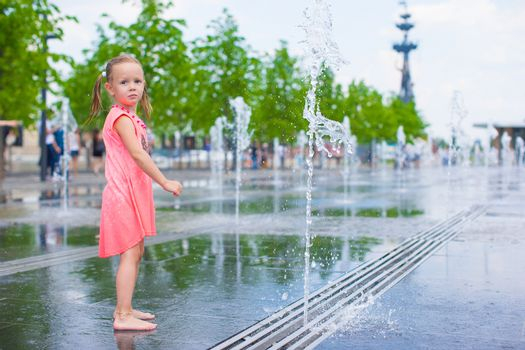 Adorable girl have fun at hot sunny summer day