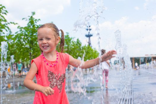 Adorable little girl have fun at hot sunny summer day