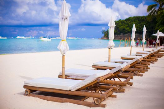 Two beach chairs on perfect tropical white sand beach