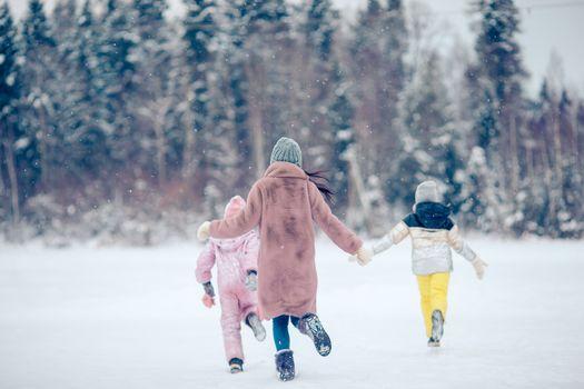 Happy family having fun outdoors in winter