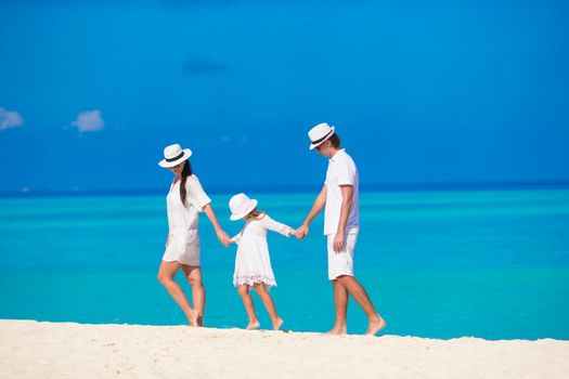 Young parent and little kid on white tropical beach