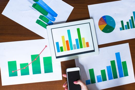 Business chart showing financial success on paper at the table