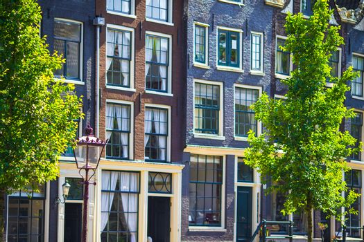 Traditional dutch buildings and blocks of flats in in old Amsterdam, Netherlands