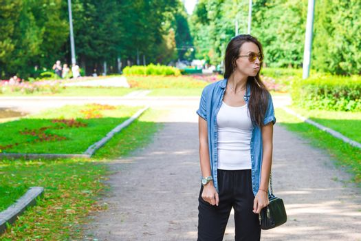 Young woman walking at summer day outdoors