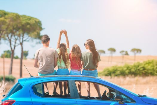 Parents and two little kids on summer car vacation