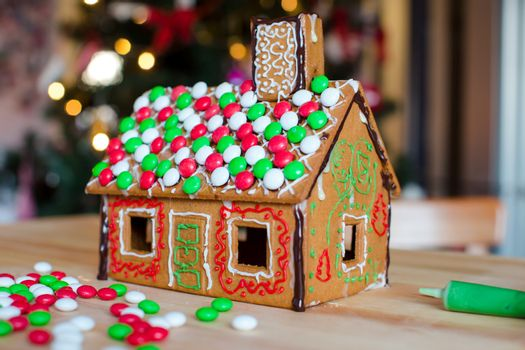 Gingerbread fairy house background of bright Christmas tree with garland