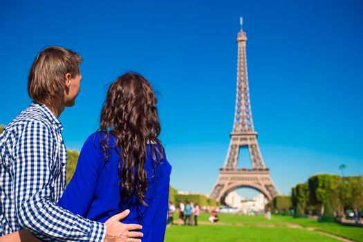 Family vacation on the Champ de Mars in Paris background the Eiffel Tower