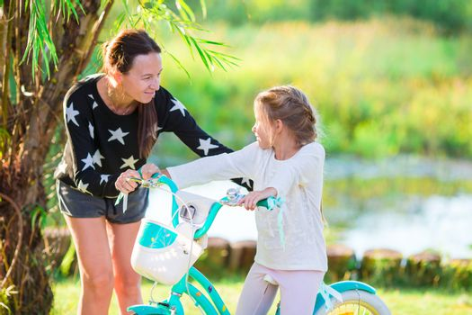 Young active family biking at summer day