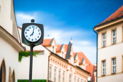 Street clock on the square in European cities