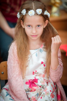 Closeup of little beautiful girl looking at camera