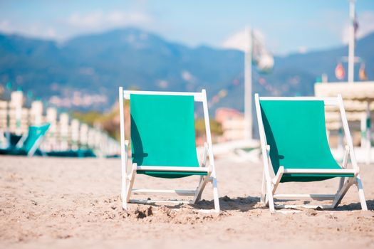 Deckchairs on european beach in Italy