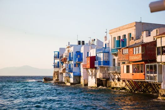 Little Venice the most popular attraction in Mykonos Island in soft evening light on Greece, Cyclades
