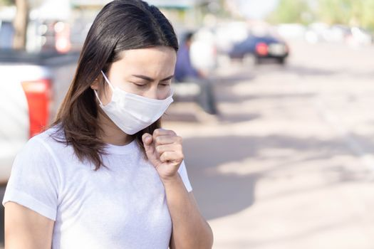 Closeup woman wearing face mask for protect air polution or virus covid 19, health care and medical concept