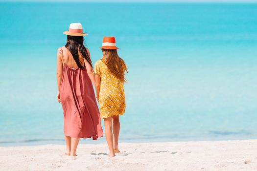 Beautiful mother and daughter in Emirates beach