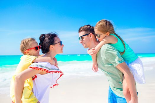 Young family on vacation on the tropical seashore