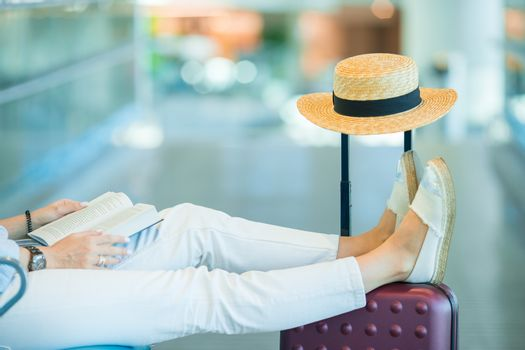 Young woman in an airport lounge waiting for landing