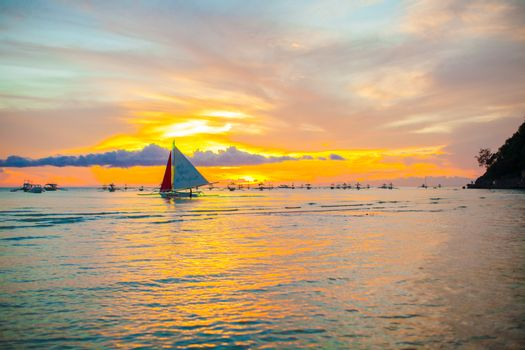 Amazing beautiful sunset with boat in skyline