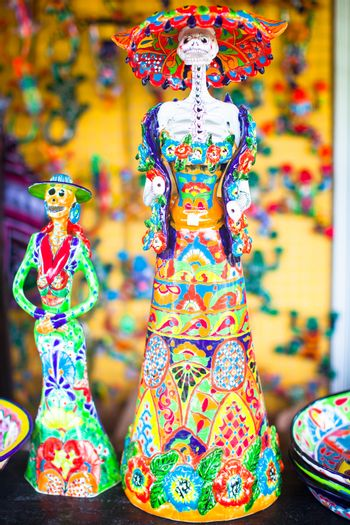 Colorful traditional mexican ceramics figures on the street market
