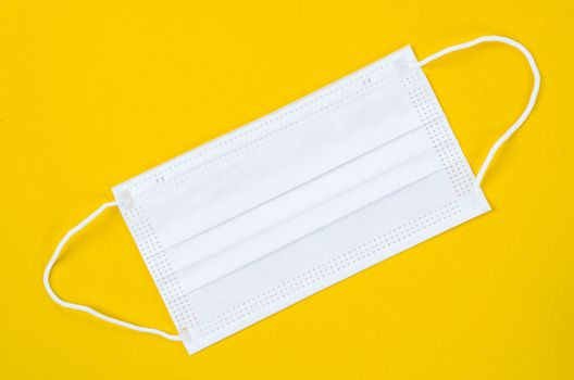 Medical mask or surgical mask with rubber ear straps.