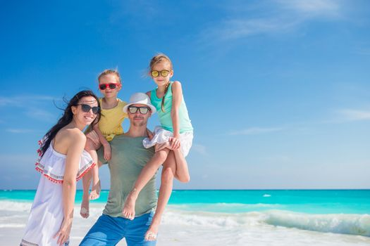 Family beach vacation. Parents with two kids portrait