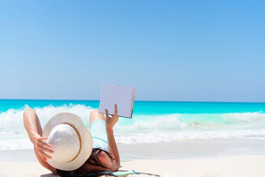 Woman with book on the seashore