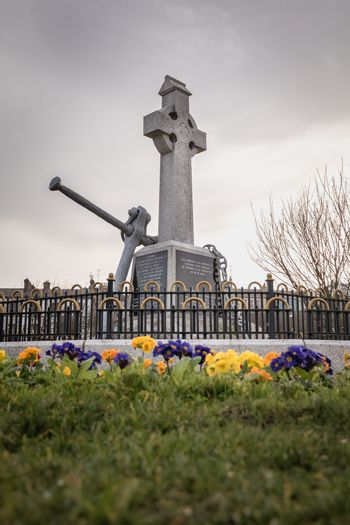 Howth near Dublin, Ireland - February 15, 2019: view of the monument was erected by the Howth fishermans association and commemorates the lives of all persons lost at sea in the city center on a winter day