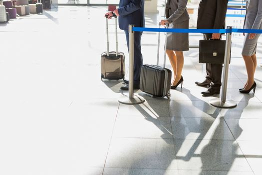 Cutout of mature businessman looking at his boarding pass