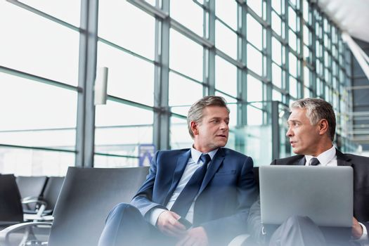 Mature businessman waiting for boarding in airport
