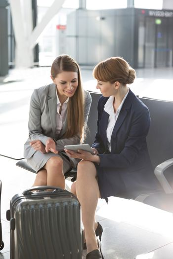 Portrait of businesswoman working while waiting for boarding in their gate
