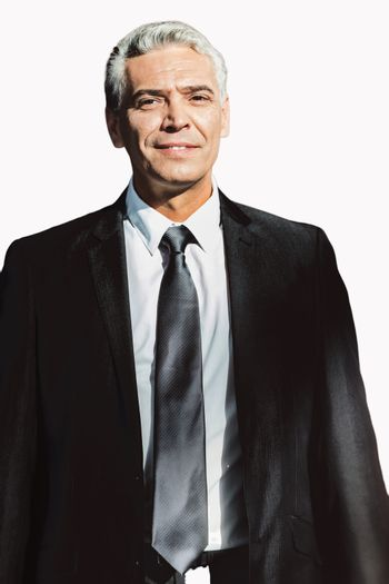 Cutout of Smiling mature businessman standing in suit