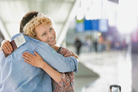Wife reuniting with her husband in airport