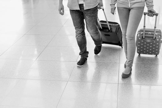 Mature man arriving with his daughter in airport looking for the