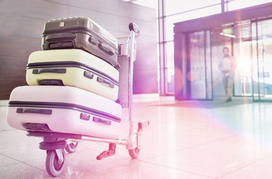 Photo of baggage on cart with lens flare