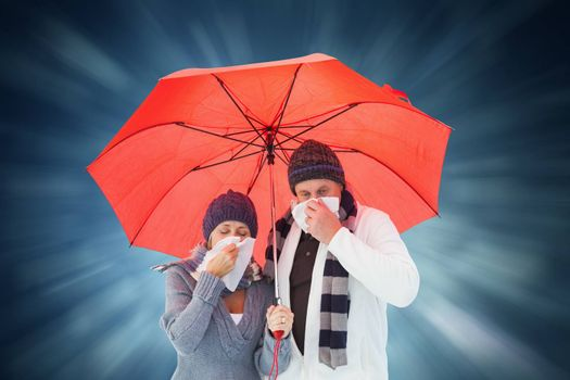 Mature couple blowing their noses under umbrella against blue abstract light spot design