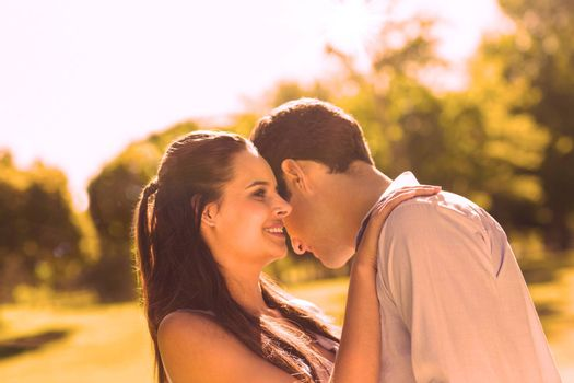 Close-up side view of a loving and happy young couple at the park