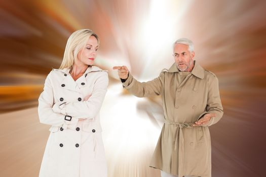 Composite image of angry couple fighting in trench coats