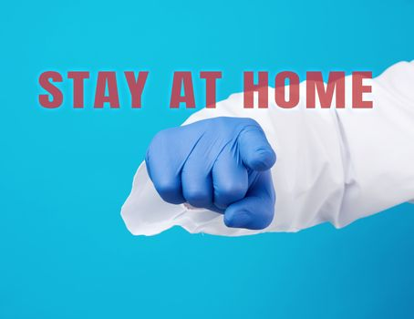 doctor's hand in a blue sterile glove shows with an index gest