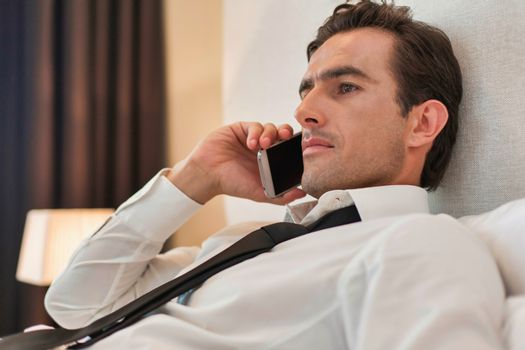 Attractive business man making phone call on smart phone