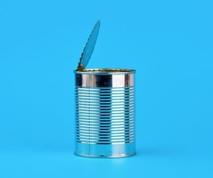 open hard iron can for food preservation on a blue background