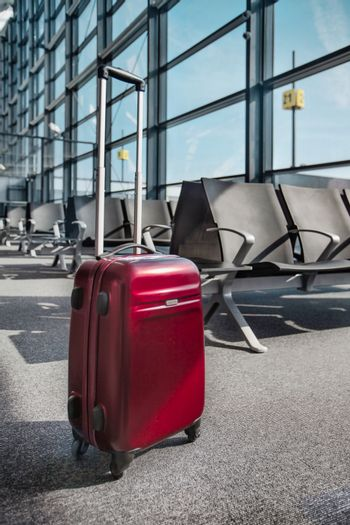 Photo of suitcase on empty boarding gate