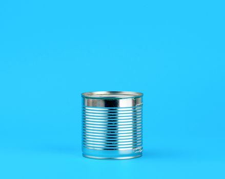 hard iron can for food preservation on a blue background
