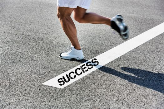Man stepping on white line with success sign