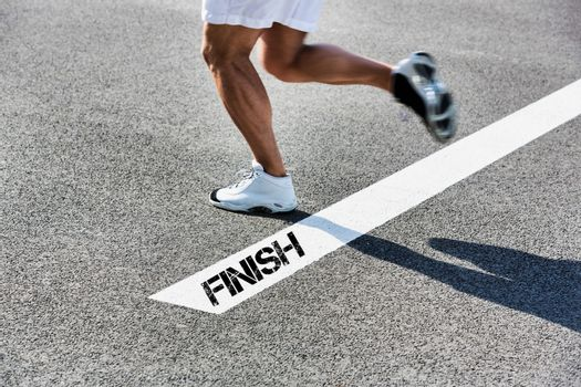 Man stepping on finish line